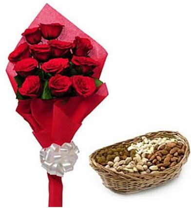 11 adet kırmızı gül ve sepette kuruyemiş  Ankara karacakaya internetten çiçek satışı